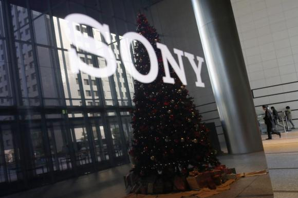 The logo of Sony Corp and a Christmas tree are reflected on the company's 4K television set at the company's headquarters in Tokyo