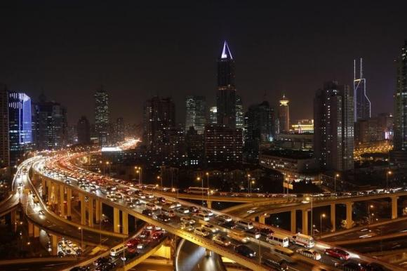 Vehicles drive on flyovers during the evening rush hour in central Shanghai