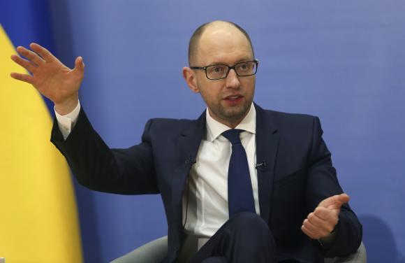 Ukrainian Prime Minister Arseny Yatseniuk attends a news conference in Kiev