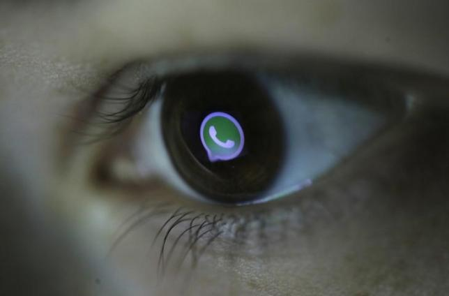 Picture illustration shows Whatsapp's logo reflected in a person's eye, in central Bosnian town of Zenica