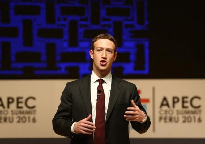 Facebook founder Mark Zuckerberg addresses the audience during a meeting of the APEC (Asia-Pacific Economic Cooperation) Ceo Summit in Lima