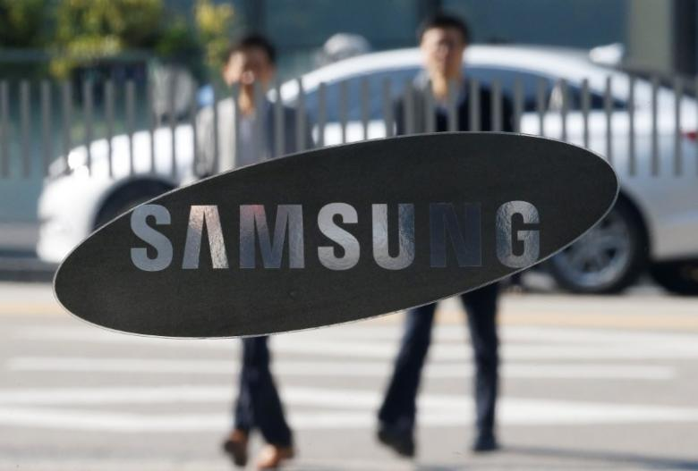 Employees walk past a building of Samsung Electronics in Seoul