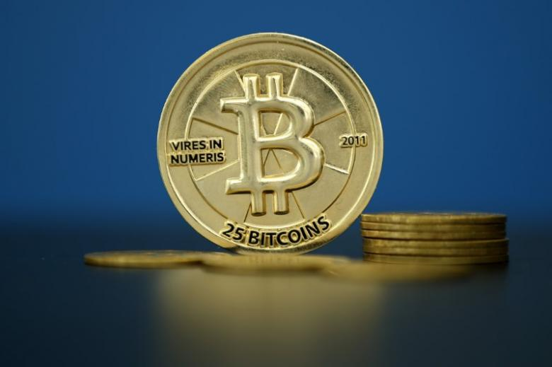 An illustration photo of Bitcoin (virtual currency) coins that are seen at La Maison du Bitcoin in Paris
